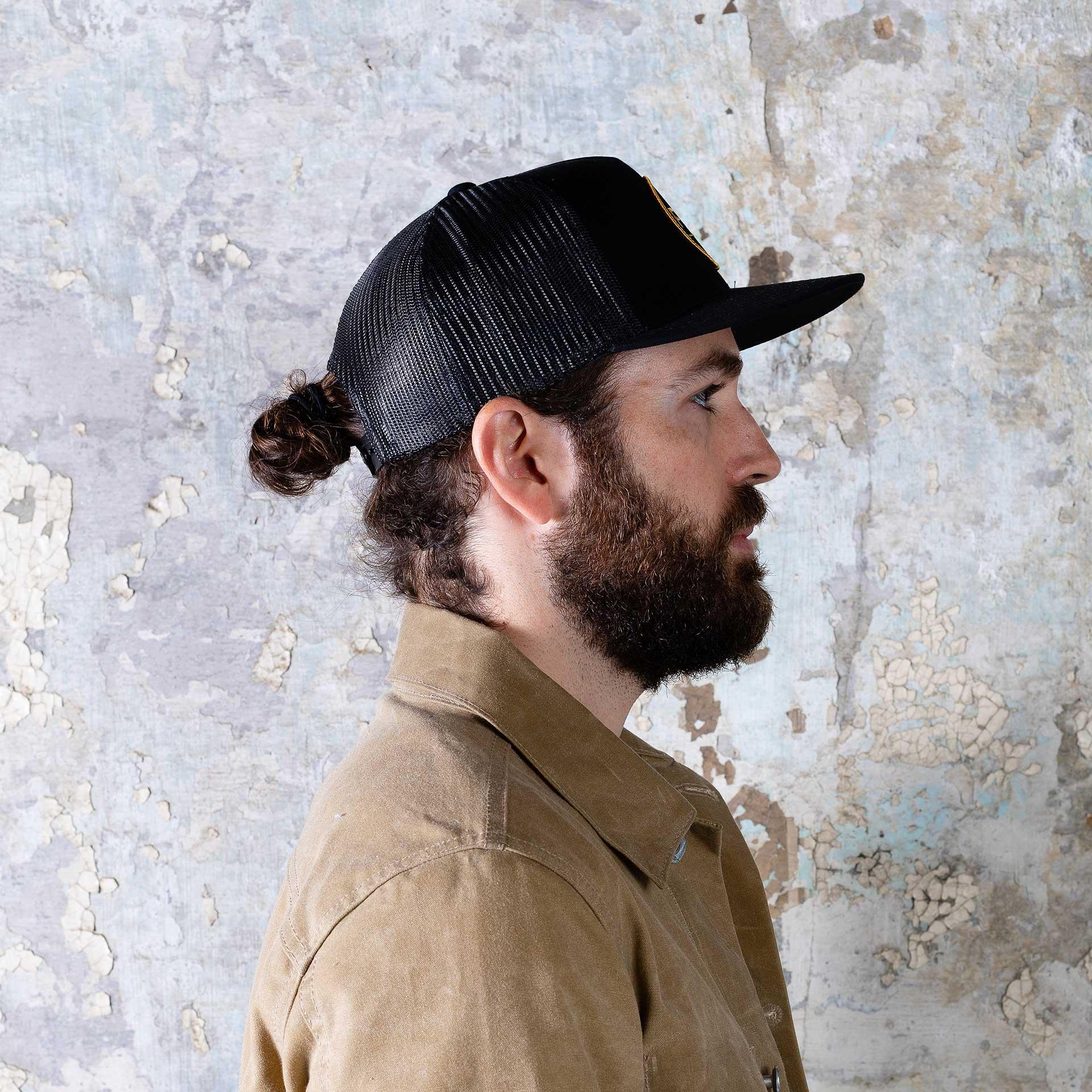 Franklin-&-Mercer-Trucker-Hat—Onbody-shot-(crop-just-below-the-shoulders)-